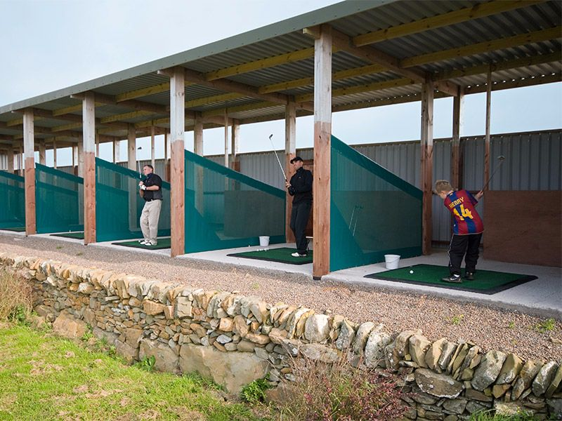 Practise your swing at our six bay driving range looking out to the sea.