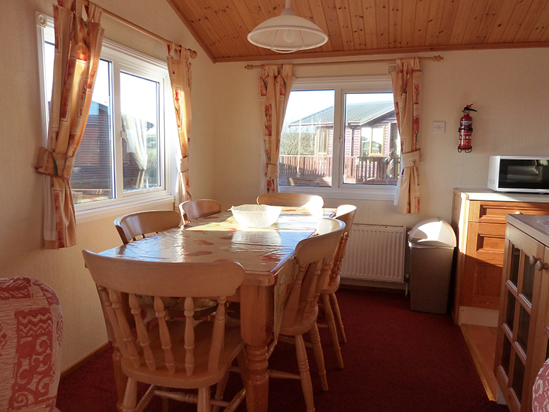 Our lodges have open plan kitchen, dining and lounge areas