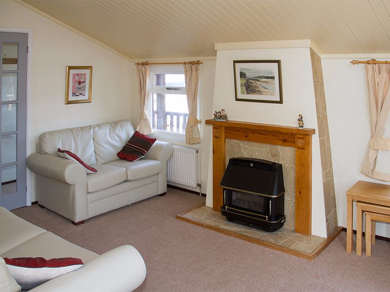 Our homely wooden lodges are warm and spacious with open plan kitchen and lounge area